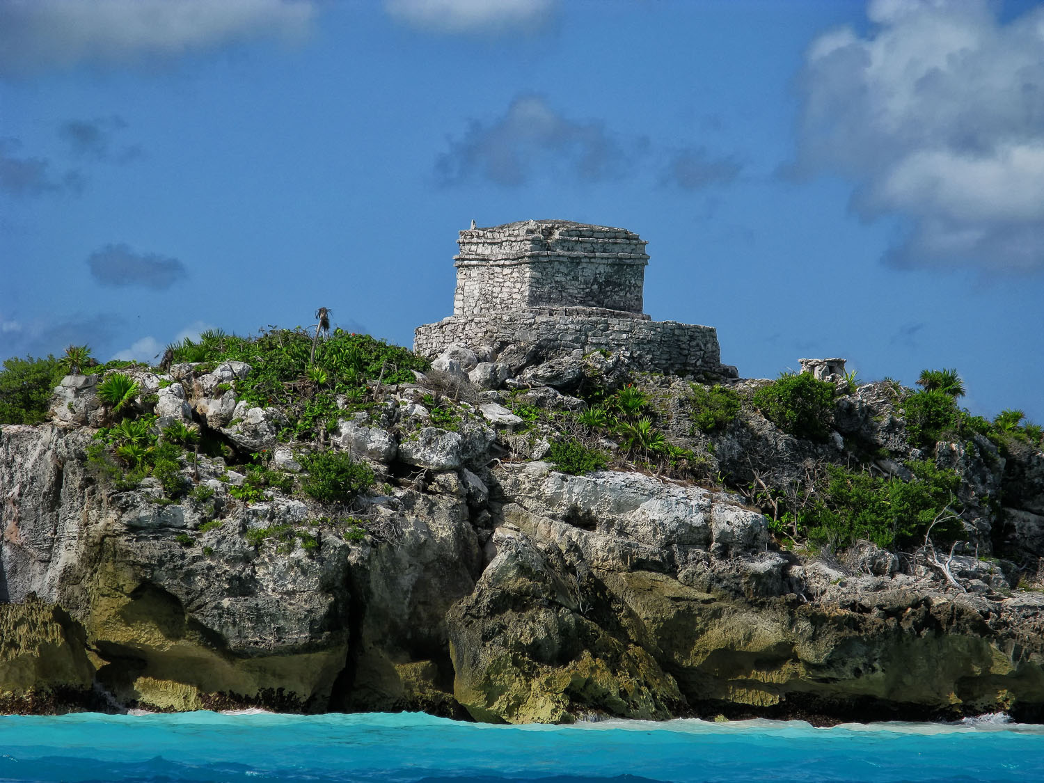 The God of Wind Temple anchors to the Caribbean Sea coastline.